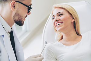 woman smiling at oral surgeon